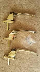 Polished brass window handles