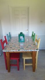 Solid pine dining table and hand painted chairs