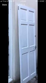 Good quality six panel newly painted door The size is 28 inch wide and 77 inch long