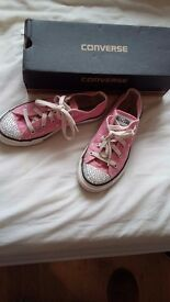 Pink converse.