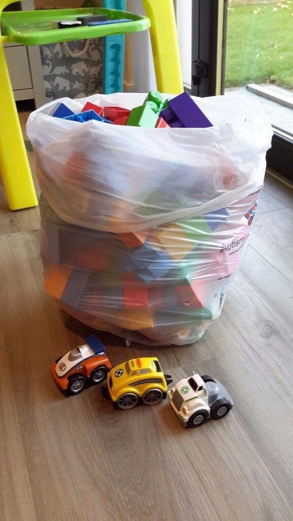 Large bag of Mega Bloks with 3 cars
