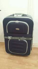 New large dark blue suitcase used just one time