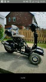 125cc trike proper rocket does 57mphthis trike is not no shitter this is a well bonded machine