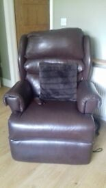 Brown leather recling massaging chair.