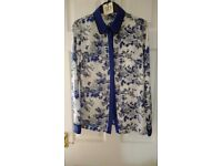 TRUE DECADENCE Hyper Print shirt. size 10. Brand New Price tag still attached. Blue Floral Design
