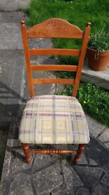 4 chairs and 2 carvers. Material seats. In very good condition