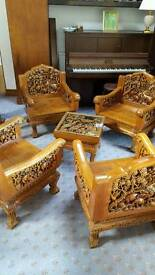 Hand carved wooden elephant chairs and table