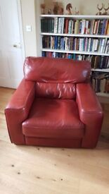 very comfortable leather arm chair , Cranberry red and in good condition