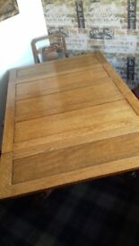 Antique dining table & four chairs
