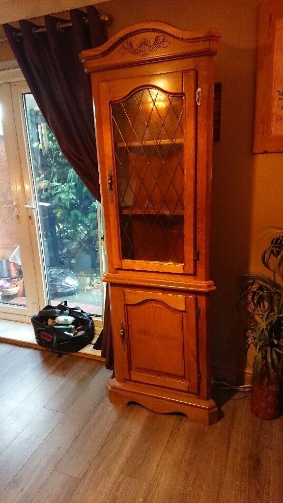 Solid pine corner display cabinet.