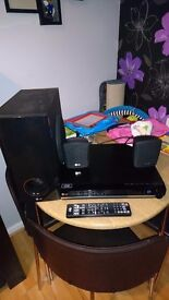 LG 2.1 Dvd home cinema system. Two 90w speakers and a 150w sub. Small but good sound quality