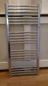 Heated towel rail with brackets
