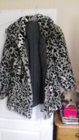 Ladies fully reversable coat by Dennis Basso