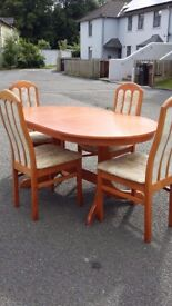 Extending Dining Table & 4 Upholstered Chairs