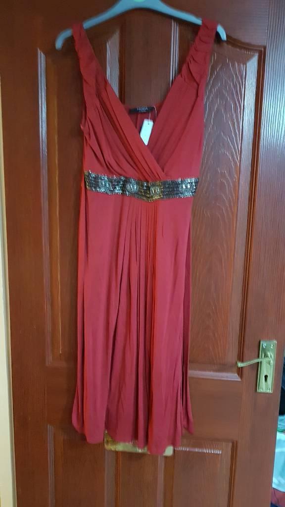 Brand new red fabric wrap dress