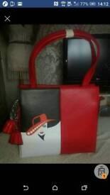 Beautiful ladies malony handbag