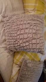Grey square cushions