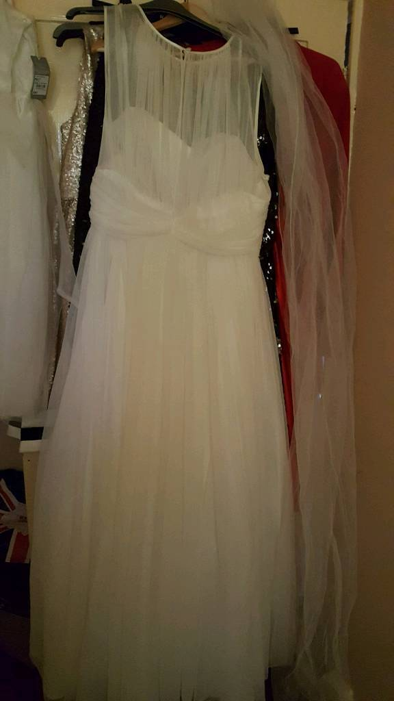 Brand new wedding dress size 20.and wedding items.