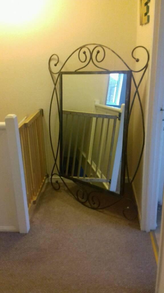 Large iron framed mirror