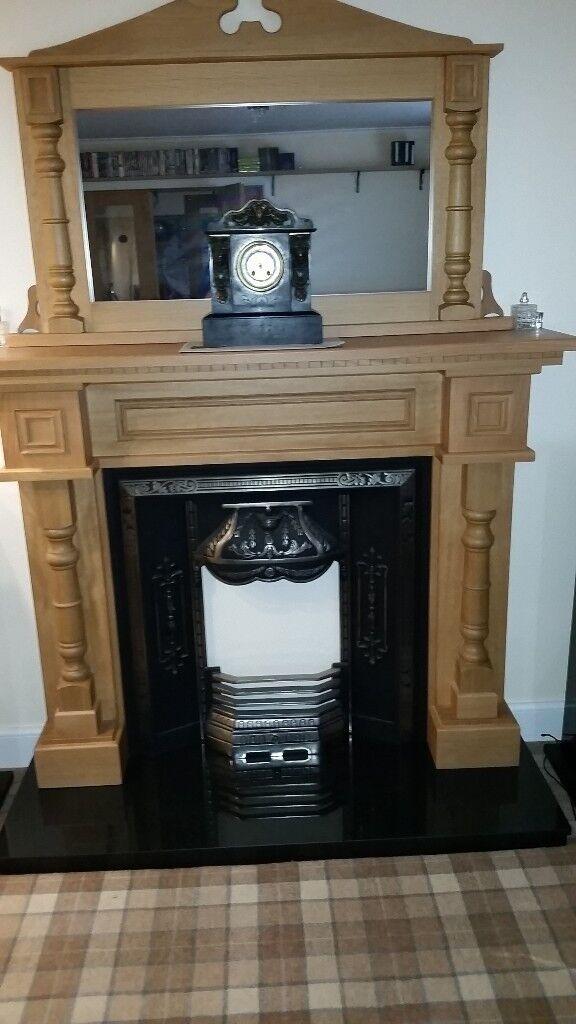 Solid Oak Surround Cast Iron Insert Granite Base
