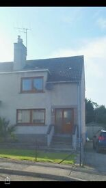 Two bedroom semi detached house with fully enclosed front and back garden for rent