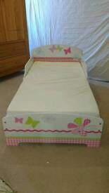 Girls toddler bed and matching bookcase. Worlds apart
