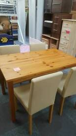 Brand new solid pine dining table and chairs