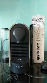 Grey Nespresso Machine with Booklet and Desclaer