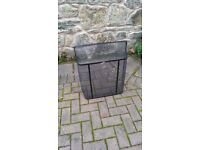 Simple, functional black fire guard with chrome handle and close mesh - in perfect condition