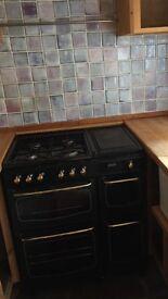 Range cooker, black, 4 doors, very heavy, all in worki g order, gas, Stoves make.