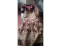 A indian wedding dress ( not worn at all ) is for sale in an immaculate condition