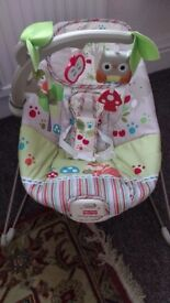 Fisher Price baby bouncer chair with vibrations and musical toys