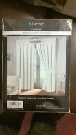 pair of pencil pleat curtains, cream coloured, lined, size 65ins x 90ins (brand new factory sealed)