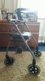 Four wheeled adult walker