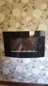Excellent condition black curved wall hung fire