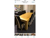 Large solid dining table and eight leather chairs