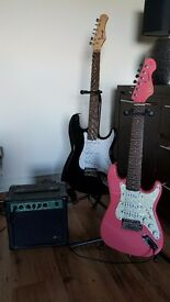 2 x Stagg electric guitars (1 full size / 1 junior pink) + amplifier, cable, stands and cases.