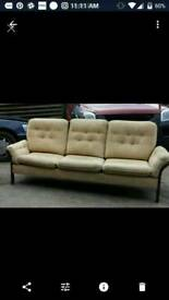 3 seater wooden settee. Removable cushions.