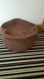 2 faux brown cushions