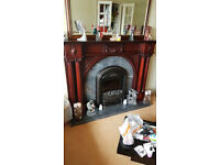 Solid wooden fire surround with coal effect electric fire.