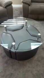 Dark brown round coffee table with 4 storage seats