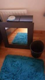 Brown leather mirror and bin
