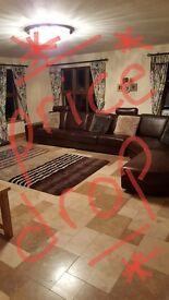Stunning Italian leather corner sofa and two seater