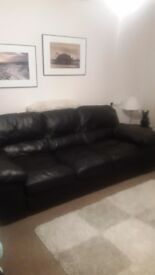 4 seater black leather sofa arm chair and storage foot stool