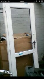 Upvc brand new back door with glass