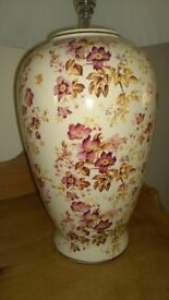 lamp base with a flower pattern design and cream shade.
