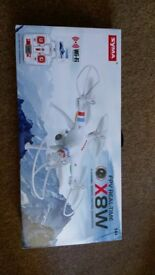 Syma x8w drone, with soare batteries and 3 months left on garentee