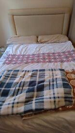 Double bed with storage compartments
