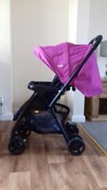 Joie pink pushchair and rain cover £35