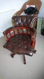 An Antique brown leather Chesterfield captains chair in good condition